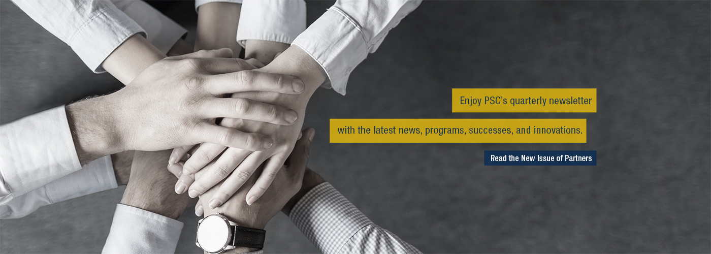Many hands in the middle of a huddle. Text: Enjoy PSC's quarterly newsletter with the latest news, programs, successes, and innovations. Read Partners Newsletter.