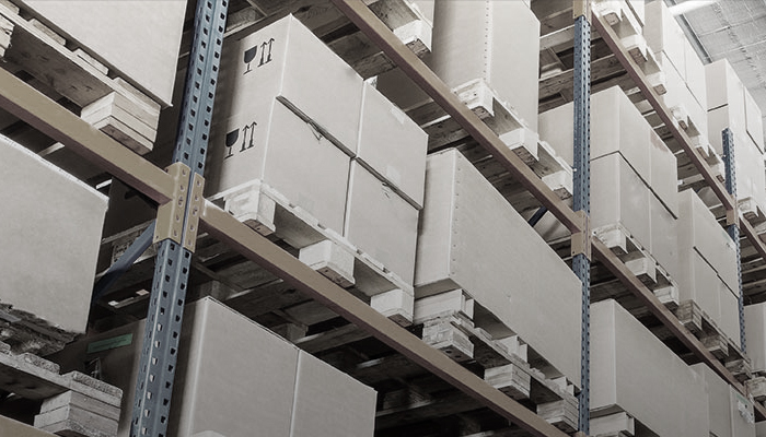 Boxes lining warehouse shelves.