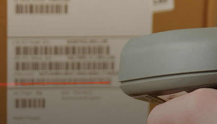 a scanner scanning the label on the side of a box.