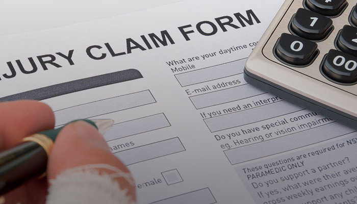 Person filling out and Injury Claim Form.