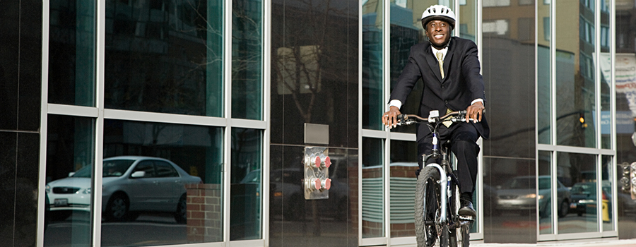 Business man riding his bike to work.